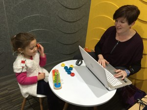 Audiologist, Emma performing Play Audiometry, with Daniela aged 3 yrs